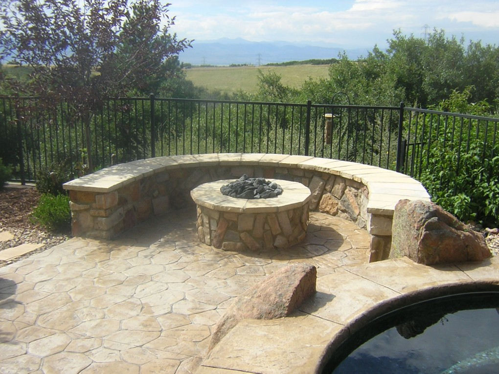 gas fire pit seating wall and stamped concrete daniels