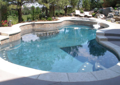 Freeform Swimming Pool With Raised Bond Beams
